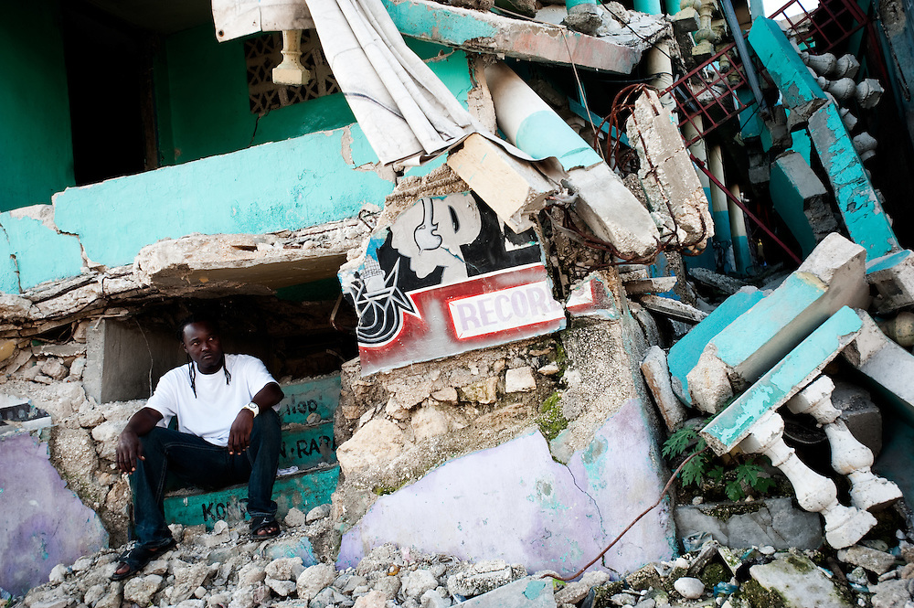In Delmas 2 area of Port au Prince, Lindor sits in the rubble of the record store he used to work in. Almost 10 months on from the earthquake which struck the city on January 12th, much of the rubble remains on the streets.