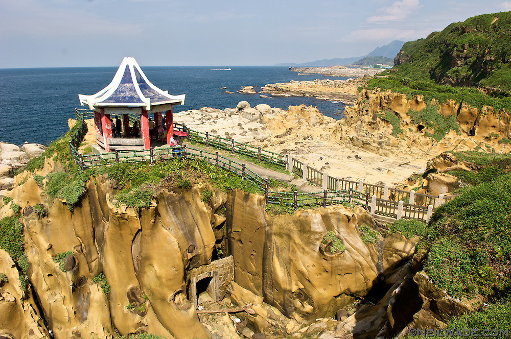 Visitors investigate the interesting rock formations along Keelung, Taiwan's Hoping Coastal Park.