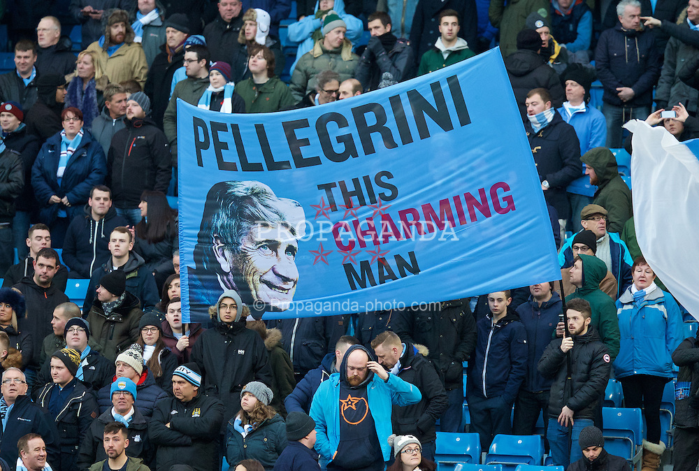 MANCHESTER, ENGLAND - Sunday, January 18, 2015: Manchester City supporters' banner 'Pellegrini This Charming Man' during the Premier League match at the City of Manchester Stadium. (Pic by David Rawcliffe/Propaganda)