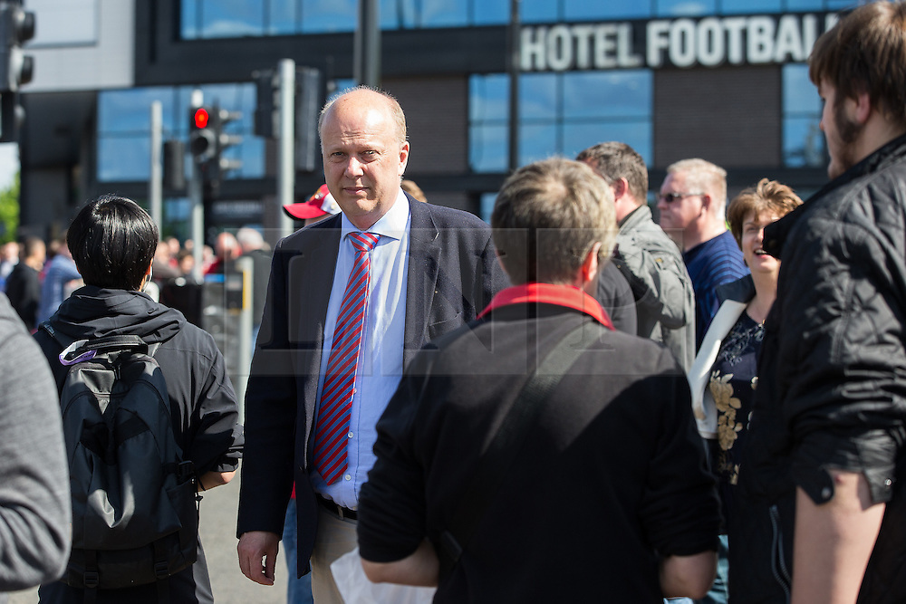 © Licensed to London News Pictures. 15/05/2016. Manchester, UK. CHRIS GRAYLING MP leaving the stadium . The scene where part of Old Trafford Stadium has been evacuated before Manchester United's final-day match against Bournemouth, due to a suspect package being found. Photo credit: Joel Goodman/LNP