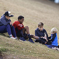 Adam Robison | BUY AT PHOTOS.DJOURNAL.COM<br /> A group of young Pontotoc fans entertain themselves by swapping shoes with each other during the pre-game announcements at Friday night game between Pontotoc and Ripley.