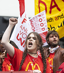 October 4, 2018 - London, UK - Fast food workers at a rally in Leicester Square as part of strike action over pay. UberEats, JD Wetherspoon, McDonald's and TGI Fridays workers are among those taking part. (Credit Image: © Rob Pinney/London News Pictures via ZUMA Wire)
