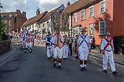 Thaxted Morris Weekend, Thaxted Essex England UK. 2-3 June 2018<br /> The 85th Meeting of the Member Clubs of the Morris Ring hosted by Thaxted Morris Men (who wear red and white stripes) who lead the Saturday evening procession to Town Street in Thaxted after a busy day of dancing in a dozen local pubs in surrounding villages in North West Essex.