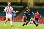 Ospreys wing Keelan Giles watches the ball, under pressure from Stade Francais full-back Hugo Bonneval during the European Challenge Cup match between Ospreys and Stade Francais at Principality Stadium, Cardiff, Wales on 2 April 2017. Photo by Andrew Lewis.
