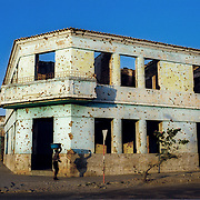Kuito, Angola                                       September, 2002<br /> <br /> Bullet holes cover most of the buildings in cetnral  Kuito, Angola. The 27-year civil war destroyed much of the infrastructure of Kuito. Photo by Lori Waselchuk/South Photographs