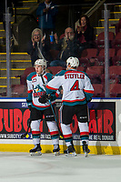KELOWNA, CANADA - JANUARY 16:  Devin Steffler #4 and Kyle Topping #24 of the Kelowna Rockets celebrate a goal against the Moose Jaw Warriors on January 16, 2019 at Prospera Place in Kelowna, British Columbia, Canada.  (Photo by Marissa Baecker/Shoot the Breeze)