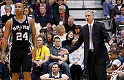 Utah Jazz assistant coach Phil Johnson, right, reacts to a foul called on Deron Williams as San Antonio Spurs forward Richard Jefferson (24) walks past during the second half of an NBA basketball game in Salt Lake City, Friday, Nov. 19, 2010. Johnson has temporarily taken over the head coaching duties while Jerry Sloan deals with the death of a family member.  (AP Photo/Colin E Braley)