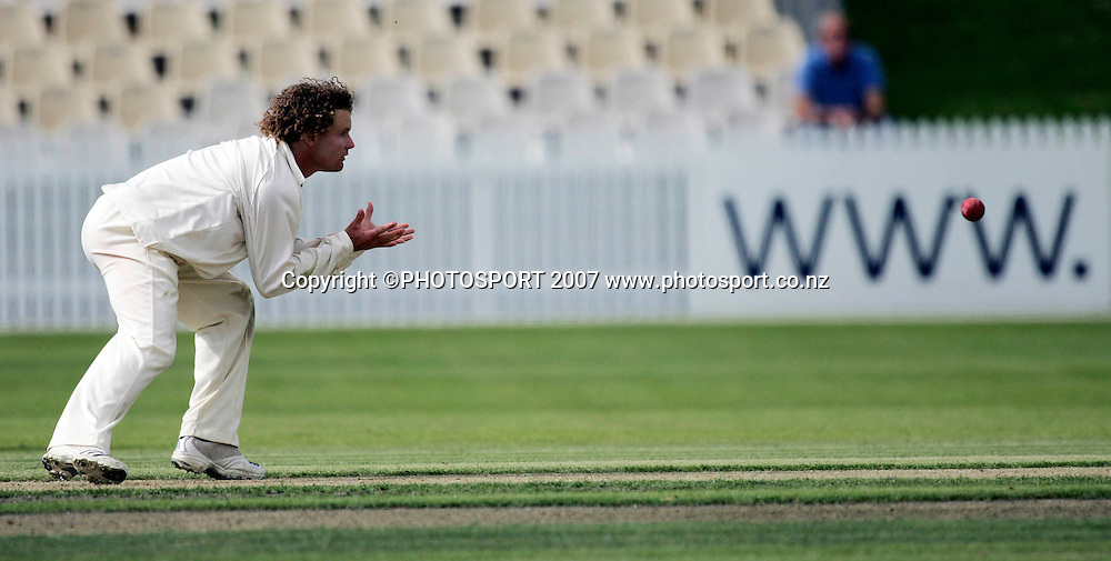 Northern District's Hamish Marshall fields the ball of his own bowling during the State Championship Cricket Final between Northern Districts and Canterbury at Seddon Park, Hamilton, New Zealand on Thursday 22 March 2007. Photo: Hagen Hopkins/PHOTOSPORT<br /><br /><br /><br />220307