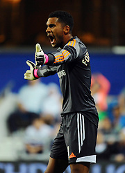 Swindon Town's Wes Foderingham  - Photo mandatory by-line: Seb Daly/JMP - Tel: Mobile: 07966 386802 27/08/2013 - SPORT - FOOTBALL - Loftus Road - London - Queens Park Rangers V Swindon Town -  Capital One Cup - Round 2