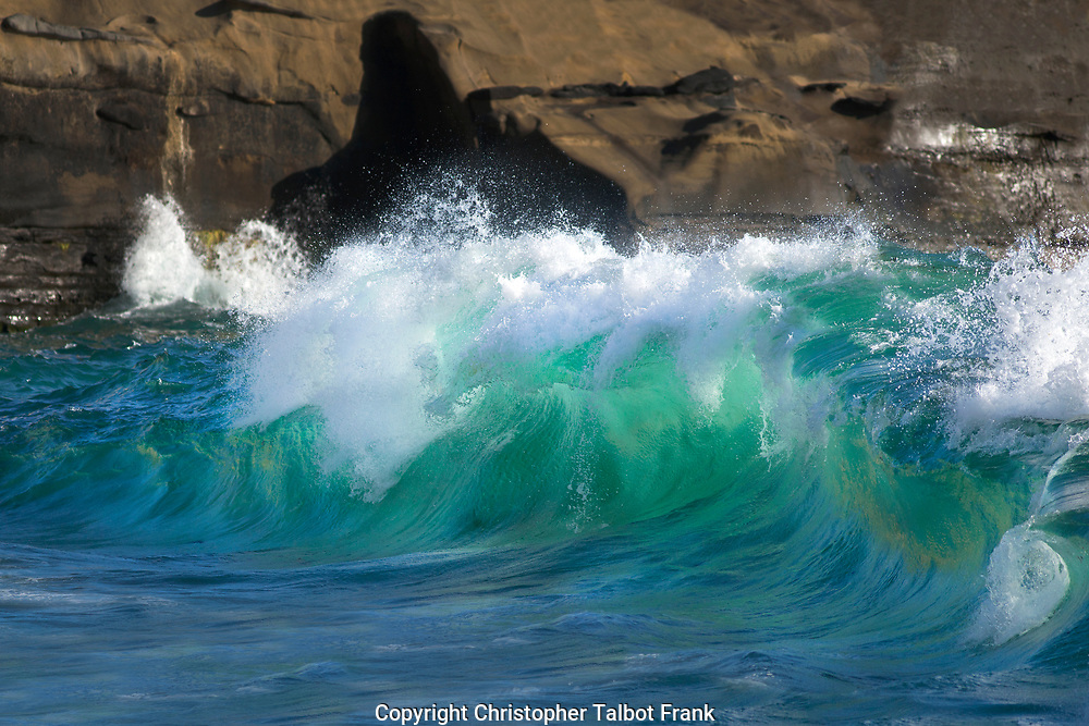 I wanted to take photos of a huge shorebreak wave in San Diego so I went to this small beach in La Jolla where I photographed this glowing green surf against a sea cave.