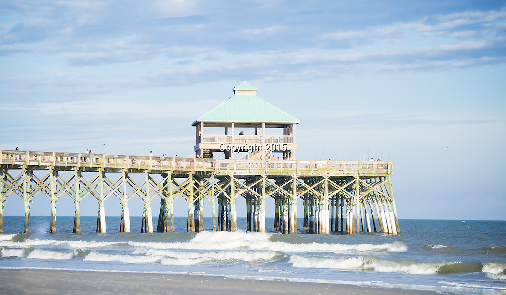 A long and tall fishing pier located on the coast of the Atlantic Ocean