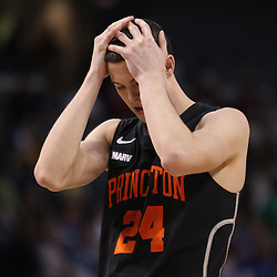 Mar 17, 2011; Tampa, FL, USA; Princeton Tigers forward Will Barrett (24) reacts following a loss to the Kentucky Wildcats in the second round of the 2011 NCAA men's basketball tournament at the St. Pete Times Forum. Kentucky defeated Princeton 59-57.  Mandatory Credit: Derick E. Hingle