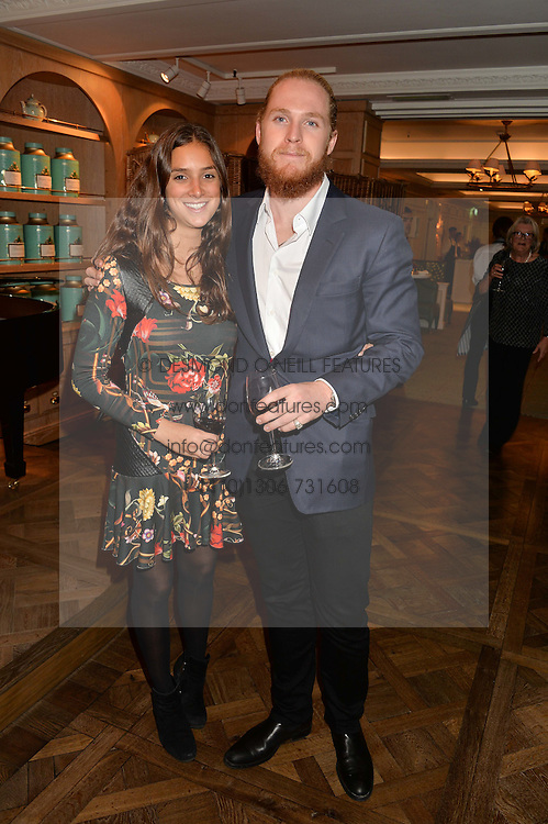 HAMISH KHAYAT member of the owning family of Fortnum & Mason and BIANCA TRISTAO at a party to celebrate the publication of 'Let's Eat meat' by Tom Parker Bowles held at Fortnum & Mason, Piccadilly, London on 21st October 2014.