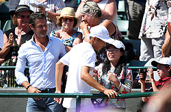 Chun Hsin Tseng celebrates winning the Boys Singles Final  with Patrick Mouratoglou (left) on day thirteen of the Wimbledon Championships at the All England Lawn Tennis and Croquet Club, Wimbledon. PRESS ASSOCIATION Photo. Picture date: Sunday July 15, 2018. See PA story TENNIS Wimbledon. Photo credit should read: Steven Paston/PA Wire. RESTRICTIONS: Editorial use only. No commercial use without prior written consent of the AELTC. Still image use only - no moving images to emulate broadcast. No superimposing or removal of sponsor/ad logos. Call +44 (0)1158 447447 for further information.