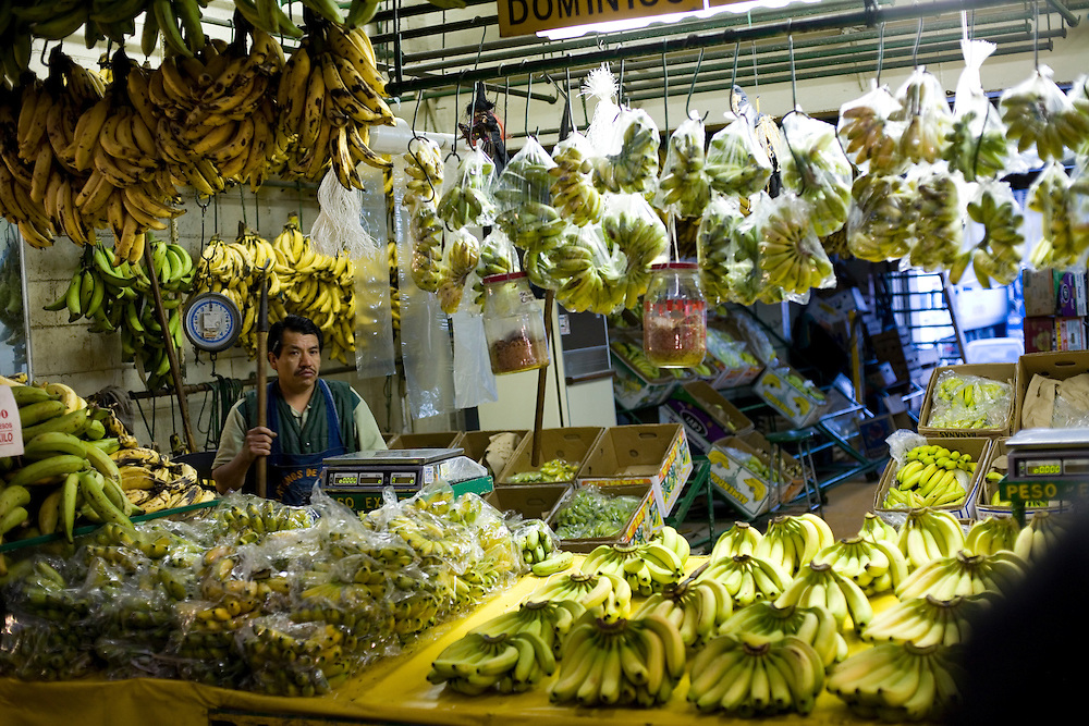 A man sells bananas at the Central de Abasto, Mexico's main fruit and vegetable market, on Tuesday, October 20, 2009, in Mexico City, Mexico.