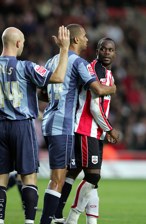 Stern John of Southampton looks at Danny Mills after being fouled by him. Southampton v Charlton Athletic, Championship, St Marys, Southampton. 3rd November 2007.