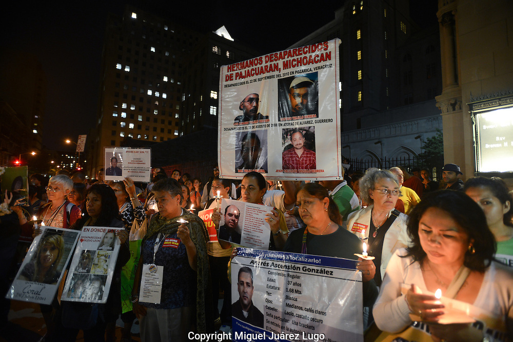 NEW YORK NY - SEPT 08, 2012.-  Mexican families hold photos of their missing and murdered sons, daughters, sisters and brothers during a Sept. 6 vigil to remember those lost in Mexico's drug war. The families have joined with American supporters as part of the Caravan for Peace with Justice, which has traveled across the U.S. all summer to draw attention to the violent consequences of the drug war on both sides of the U.S.- Mexico border. The war has left by some estimates more than 60,000 people dead or missing since it began nearly six years ago. (PHOTO: MIGUEL JUAREZ LUGO)