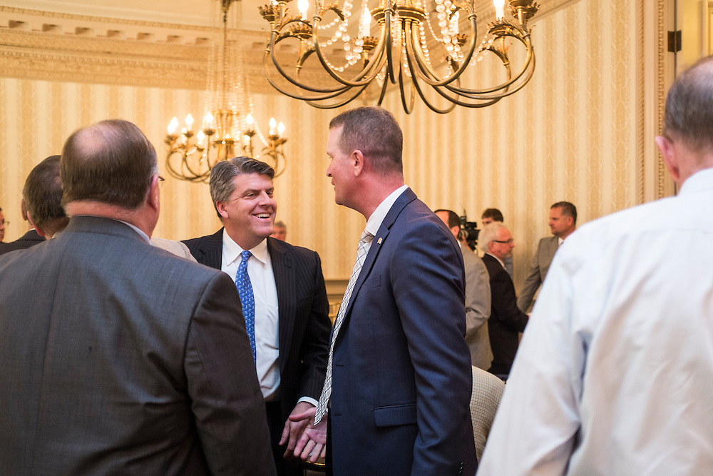 John Born, center, chats with attendees after the Ohio University  State Government Alumni Luncheon on Tuesday, May 5, 2015.  Photo by Ohio University  /  Rob Hardin