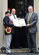 © Licensed to London News Pictures. 18/10/2012. Westminster, UK A petition is handed in at Downing Street calling for the regiment to be saved. Members past and present from the 2nd Battalion of The Royal Regiment of Fusiliers march on Parliament today 18 October 2012 to hear a debate in the House on the future of their regiment. The regiment's existence is threatened by the governments plans to reduce the armed forces by 20,000 personel. Photo credit : Stephen Simpson/LNP