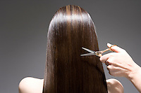 Woman having haircut rear view