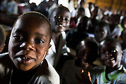 Children in class at the Mboga primary school in the town of Kibati, on the outskirts of Goma, Eastern Democratic Republic of Congo on Friday December 12, 2008. Classes started again on Dec 1 after the school was occupied during 8 weeks by IDPs fleeing fighting.