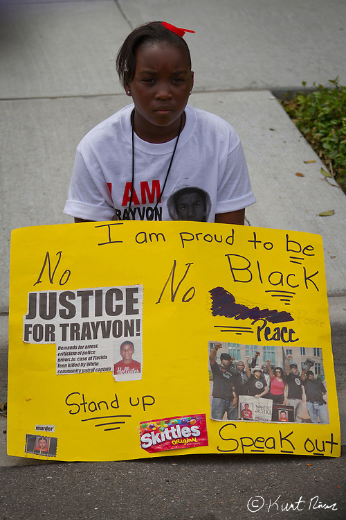 March 31, 2012 - Sanford, Florida, U.S. - A child holds a sign in the streets of Sanford, Florida for the justice of Treyvon Martin.