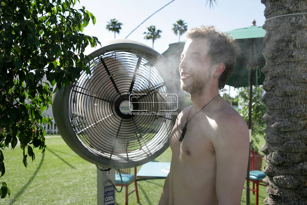 18th April 2009. Indio, California. British singer James Morrison cools down, as temperatures exceeded 100F at the Coachella Music Festival..PHOTO © JOHN CHAPPLE / REBEL IMAGES.tel +1 310 570 9100    john@chapple.biz