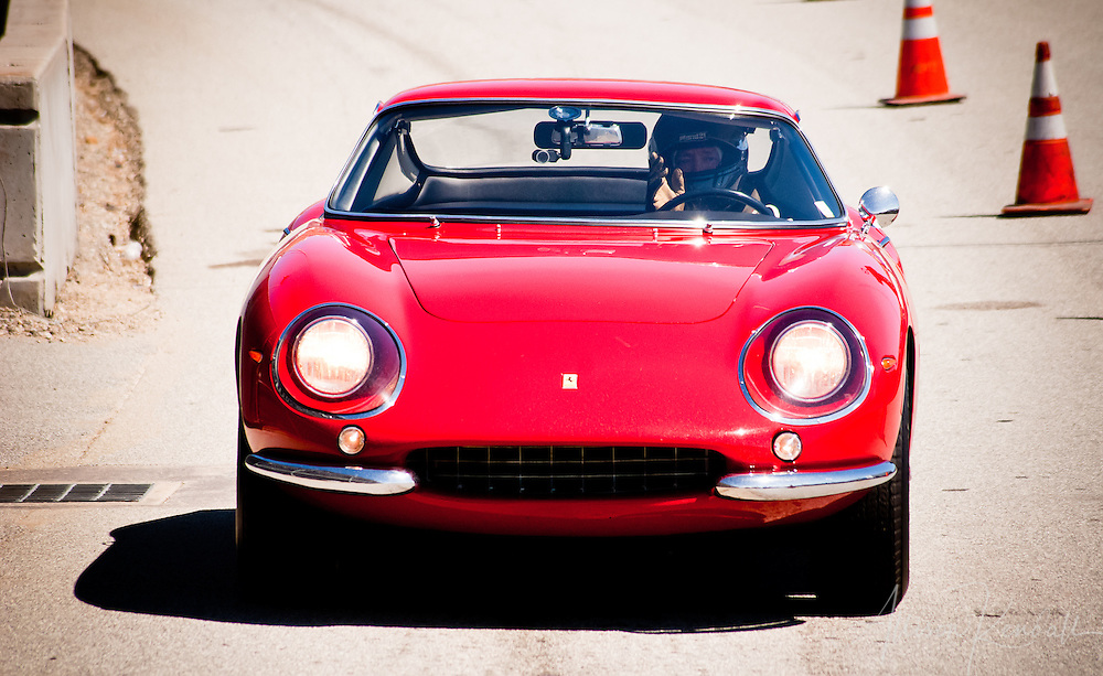 A vintage Ferrari exits the track after a race, at Laguna Seca during the Reunion events of Monterey Car Week