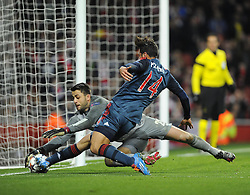 Arsenal's Lukasz Fabianski beats Bayern Munich's Claudio Pizarro to the ball - Photo mandatory by-line: Joe Meredith/JMP - Tel: Mobile: 07966 386802 19/02/2014 - SPORT - FOOTBALL - London - Emirates Stadium - Arsenal v Bayern Munich - Champions League - Last 16 - First Leg