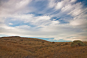 Rattlesnake Slope Wildlife Area.  Photograph of desert scene with clouds.  Landscape photography by Michael Kloth.