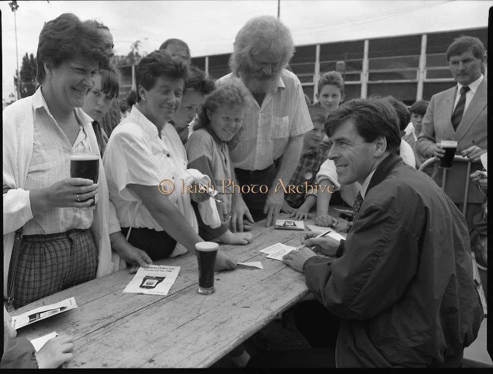 "Guinness Family Day At The Iveagh Gardens. (R83)..1988..02.07.1988..07.02.1988..2nd  July 1988..The family fun day for Guinness employees and their families took place at the Iveagh Gardens today. Top at the bill at the event were ""The Dubliners"" who treated the crowd to a performance of all their hits. Ireland's penalty hero from Euro 88, Packie Bonner, was on hand to sign autographs for the fans...Packie Bonner is pictured signing autographs for the fans after his heroics at Euro 88."