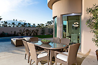 Outdoor table on patio by swimming pool
