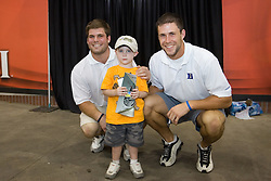 27 May 2007: Duke Blue Devils goalkeeper Rob Schroeder (15) and midfielder Bo Carrington (31) pose with a fan at M&T Bank Stadium in Baltimore, MD.
