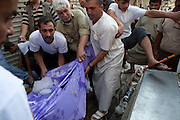 The bodies of a family of five who were killed  in their home by a Syrian government air strike attack in Karm al-Tarib, near Aleppo's international airport.Aleppo, Syria August 17,2012. (Photo by Heidi Levine/Sipa Press).