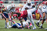 FAYETTEVILLE, AR - OCTOBER 31:  Alex Collins #3 of the Arkansas Razorbacks runs the ball and is tripped up during a game against the UT Martin Skyhawks at Razorback Stadium on October 31, 2015 in Fayetteville, Arkansas.  The Razorbacks defeated the Skyhawks 63-28.  (Photo by Wesley Hitt/Getty Images) *** Local Caption *** Alex Collins
