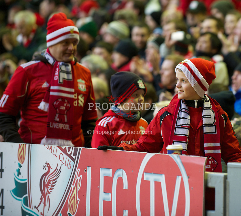 LIVERPOOL, ENGLAND - Saturday, December 10, 2011: Liverpool supporters during the Premiership match against Queens Park Rangers at Anfield. (Pic by David Rawcliffe/Propaganda)