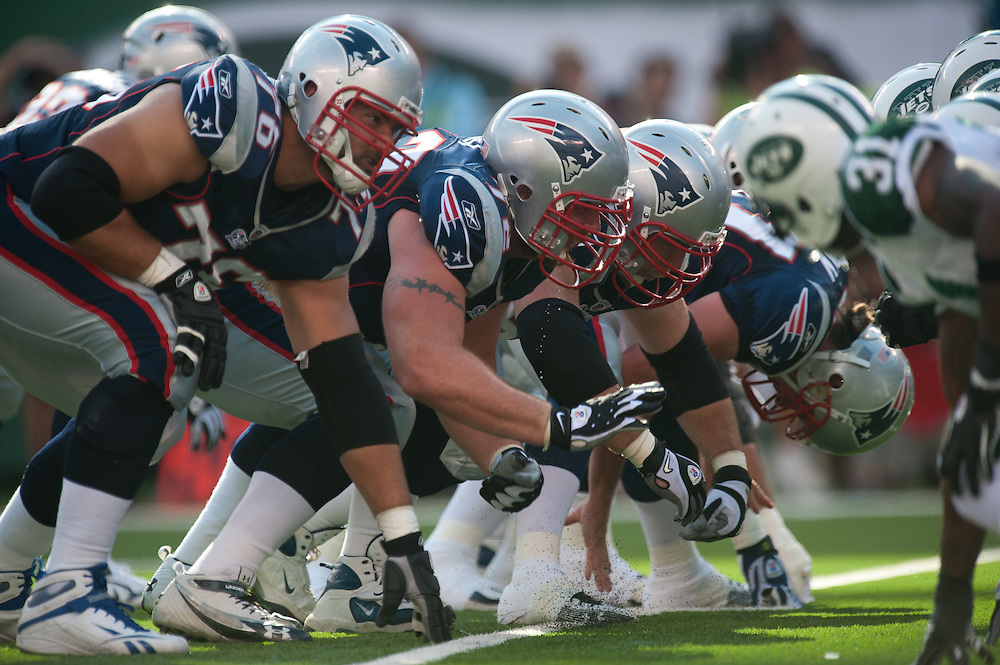 EAST RUTHERFORD, NJ - SEPTEMBER 19: The New England Patriots offense on the line of scrimmage just after the snap during the game against the New York Jets on September 20, 2010 at the New Meadowlands Stadium in East Rutherford, New Jersey.The Jets defeated the Patriots 28 to 14. (Photo by Rob Tringali)