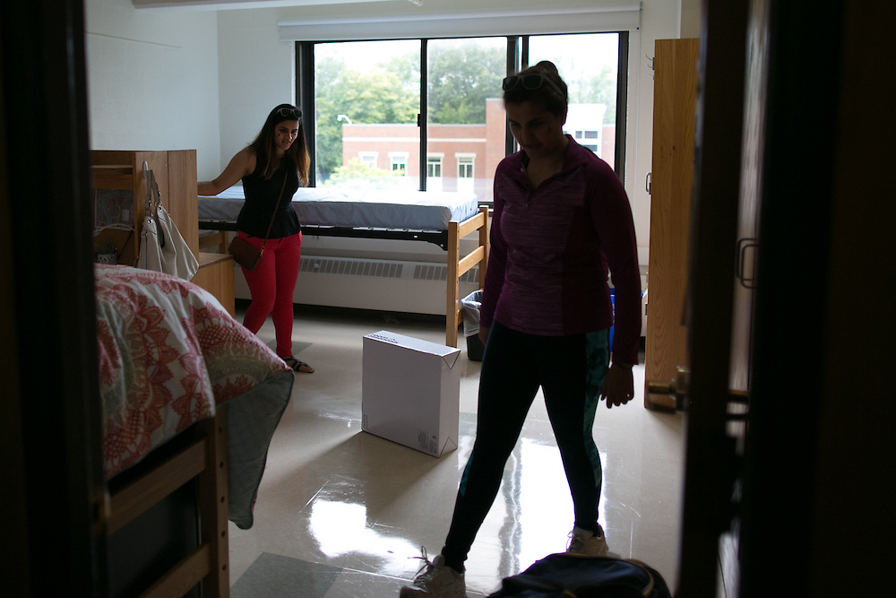 Swornima Ghimire of Green Lake, Wisconsin, left, moves into her dorm at Susan B. Anthony Hall with the help of her sister Anima, right, on move-in day for new students at the University of Rochester on Tuesday, August 25, 2015. Swornima is a freshman, and Anima is a fifth-year student at the University.
