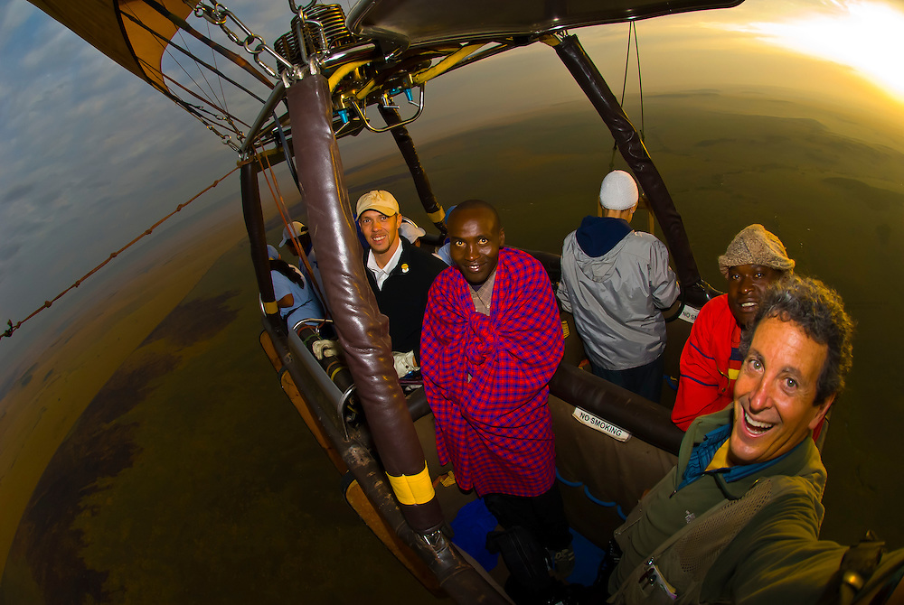 Blaine Harrington (on right) photographing from a hot air balloon over Masai Mara National Reserve, Kenya