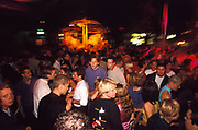 Large crowd of people dancing outdoors, Quart festival, Kristiansands Norway 2000