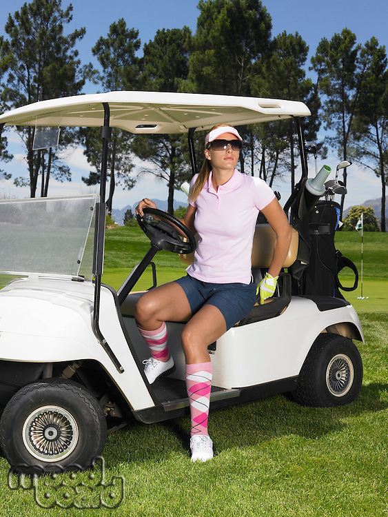 Woman in Golf Cart