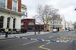 © Licensed to London News Pictures. 10/03/2019. London, UK. A police evacuation   is in operation outside Gloucester Road tube station after reports of a falling plank of wood from a nearby building site. High winds and rain have caused problems across the south of England, with flights cancelled and homes left without power. Photo credit: Ray Tang/LNP