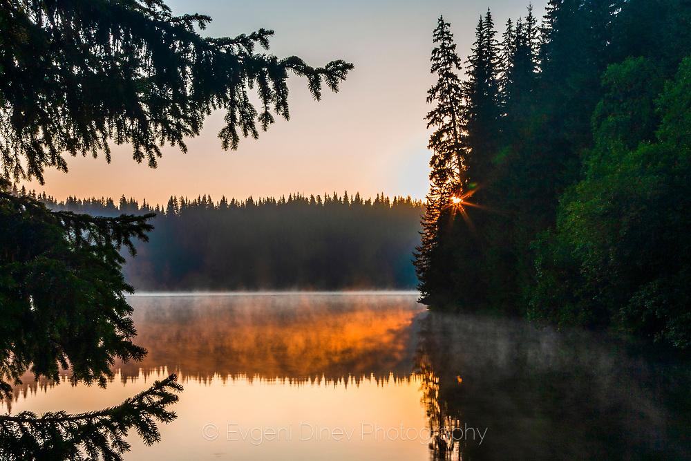 Morning vapors from the lake at sunrise