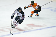 Robert Morris forward Greg Gibson skates the puck around RIT forward Josh Mitchell during the Atlantic Hockey final at the Blue Cross Arena in Rochester on Saturday, March 19, 2016.