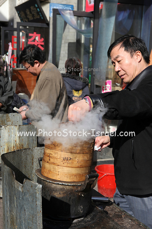 China, Beijing, Busy pedestrian street market Food Vendor