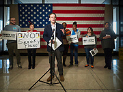 "31 OCTOBER 2019 - DES MOINES, IOWA: MATT SINOVIC, Executive Director of Progress Iowa, speaks against proposed Republican changes to the Affordable Care Act during a protest in the Neil Smith Federal Building in Des Moines. A small crowd of people came to the federal building, where US Senators Chuck Grassley's (R-IA) and Joni Ernst's (R-IA) offices are, to deliver a petition protesting the Senate's vote that critics say would allow ""spooky junk health insurance plans"" with limited coverage and would allow insurance companies to deny coverage to people with pre-existing conditions.          PHOTO BY JACK KURTZ"