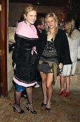 Sisters FIONA & OLYMPIA SCARRY at a party hosted by Daniella Helayel of fashion label ISSA held at Taman Gang, 141 Park Lane, London on 15th February 2006.<br />