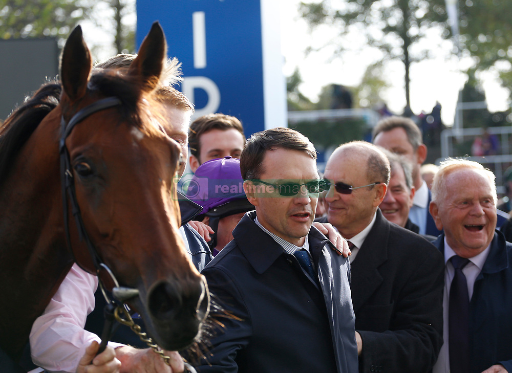 Trainer Aidan O'Brien (centre) after Hydrangea won The QIPCO British Chahamions Fillies & Mares Stakes Race run during Qipco British Champions Day at Ascot Racecourse.