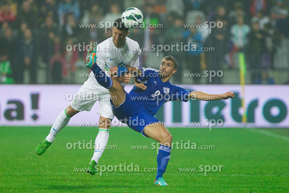Bojan Jokic of Slovenia vs Dimitris Christofi of Cyprus during football match between National teams of Slovenia and Cyprus in 3rd Round of Group E of FIFA World Cup 2014 Qualification on October 12, 2012 in Stadium Ljudski vrt, Maribor, Slovenia. (Photo By Vid Ponikvar / Sportida)