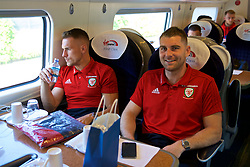 RUNCORN, ENGLAND - Tuesday, May 22, 2018: Wales' Aaron Ramsey and Sam Vokes travel by train as the squad heads to Heathrow for a flight to Los Angeles ahead of the international friendly match against Mexico. (Pic by David Rawcliffe/Propaganda)
